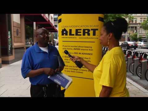 Barbara Floyd Jones interviews man on the street about loan scams
