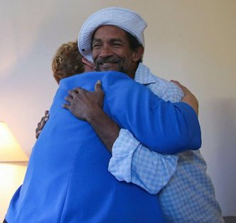 Martha Kegel hugs a newly housed veteran
