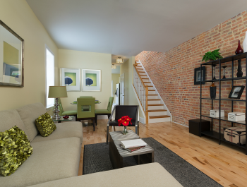 A furnished living room inside a row house.