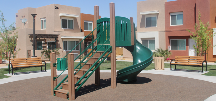 Green slide in the middle of an apartment complex