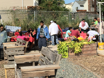 Residents revitalize a vacant lot, adding benches, a garden and a stage