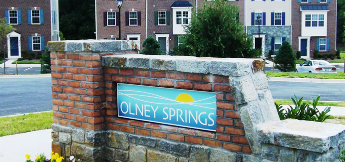 "Brick-faced sign that says ""Olney Springs"""