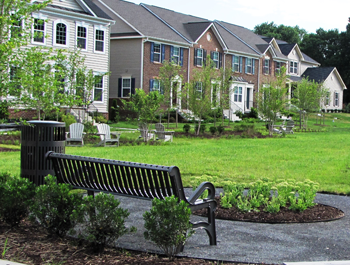 A black bench and a row of multifamily housing