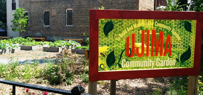 A community garden with a bright green sign