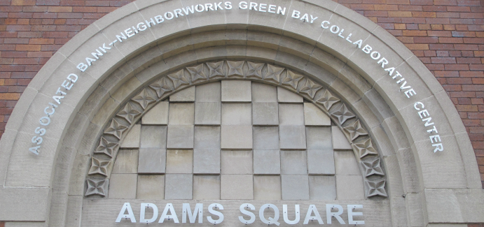 Arch over a building reading: Associated Bank-NeighborWorks Green Bay Collaborative Center Adams Square.