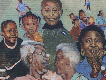 A mural of seniors and children