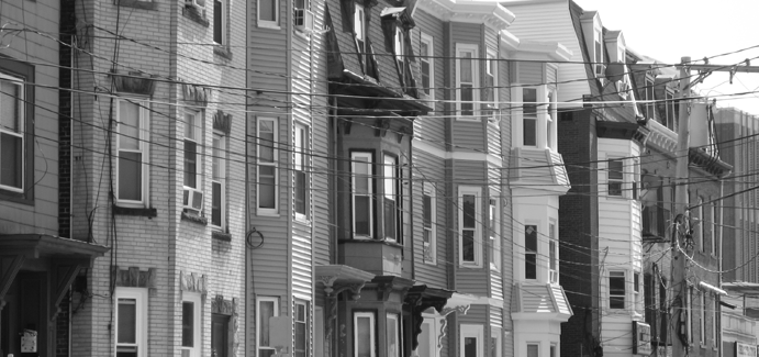 Grayscale photo of rowhouses