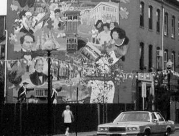 Grayscale photo of a mural depicting various people in a city