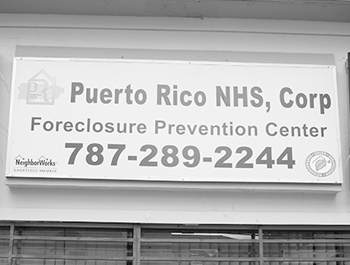 A sign on a building that says Puerto Rico NHS Corp Foreclosure Prevention Center