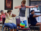 Senior citizens get fit while chair sitting