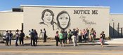 Mural says 'notice me' on behalf of girls